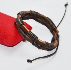 Коричневый кожаный браслет с намоткой из чёрного вощёного шнура купить. Цена 69 грн или 220 руб.