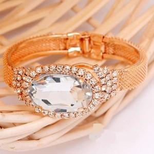 Жёсткий браслет «Сокровище» в виде позолоченной кальчуги с большим овальным камнем купить. Цена 220 грн