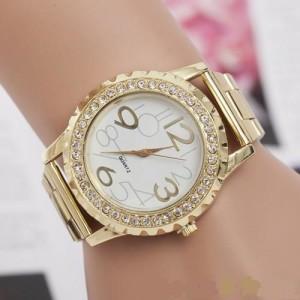 Чудесные часы «Kanima» золотого цвета с крупными цифрами, стразами и металлическим бралетом фото. Купить