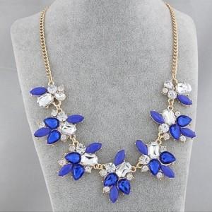 Праздничное ожерелье «Кокетка» с синими и прозрачными камнями в оправе из металла под золото купить. Цена 195 грн