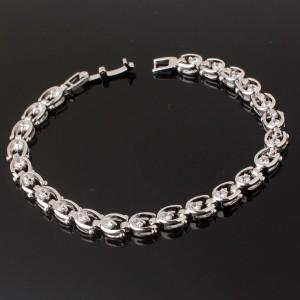 Изумительный браслет «Подковки» с прозрачными фианитами и платиновым напылением купить. Цена 340 грн или 1065 руб.