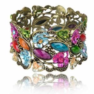 Восточный браслет «Флория» с цветами и разноцветными камнями в металле под бронзу купить. Цена 110 грн или 345 руб.
