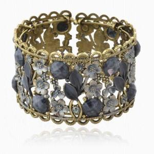 Серый браслет «Флорида» в восточном стиле с камнями и цветочками в металле купить. Цена 110 грн или 345 руб.