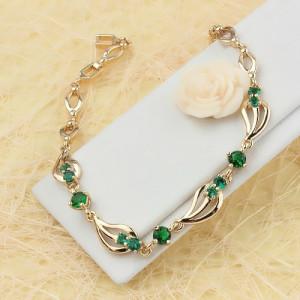 Таинственный браслет «Амазонка» с зелёными фианитами и покрытием из золота фото. Купить