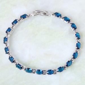 Замечательный браслет «Дунай» с платиновым покрытием и овальными синими цирконами фото. Купить