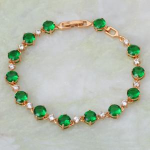 Волшебный браслет «Романтика» с зелёными и бесцветными фианитами и 24-х каратной позолотой фото. Купить