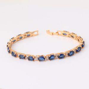 Шикарный браслет «Индиго» с овальными синими цирконами и высококлассной позолотой фото. Купить