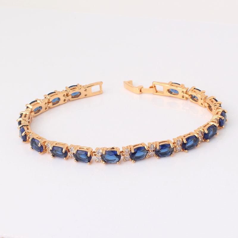 Шикарный браслет «Индиго» с овальными синими цирконами и высококлассной позолотой купить. Цена 399 грн