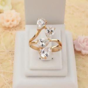 Игривое кольцо «Соблазн» с четырьмя прозрачными фианитами с покрытием из золота купить. Цена 199 грн