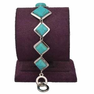 Традиционный браслет из бирюзы в серебристой оправе из металла в форме ромба фото. Купить