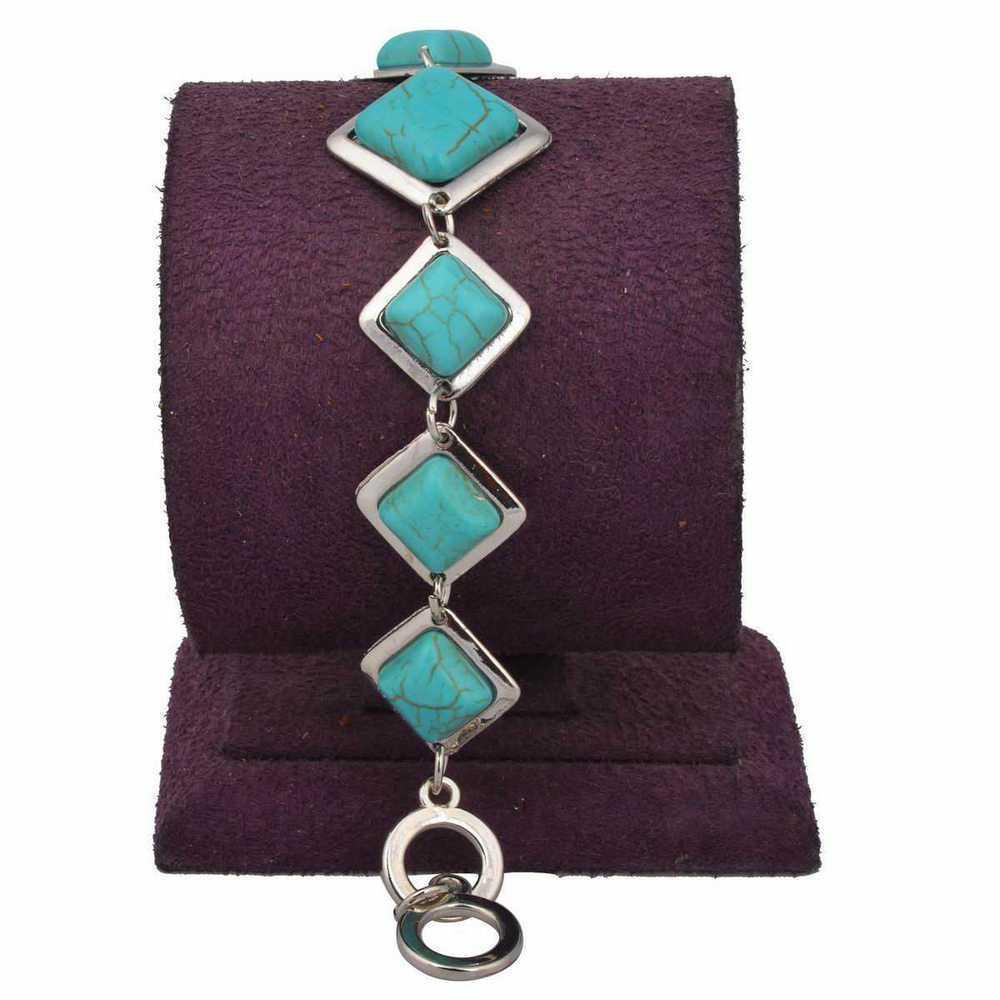 Традиционный браслет из бирюзы в серебристой оправе из металла в форме ромба купить. Цена 225 грн