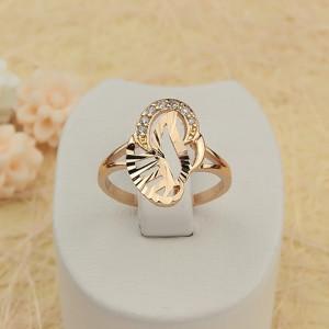 Абстрактное кольцо «Алтарь» необычной формы с небольшими фианитами и покрытием из золота купить. Цена 175 грн или 550 руб.