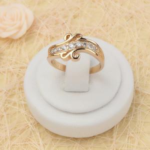 Красивое кольцо «Арго» витиеватой формы с бесцветными фианитами и качественной позолотой купить. Цена 185 грн