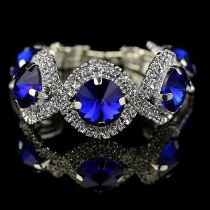Торжественный браслет «Сапфирит» с крупными синими камнями и прозрачными стразами в белом металле фото. Купить