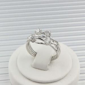 Переплетёное кольцо «Млечный путь» с четырьмя бесцветными цирконами и родиевым покрытием купить. Цена 175 грн