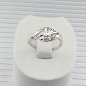 Утончённое кольцо «Орион» серебряного цвета с фианитами и напылением из родия фото. Купить