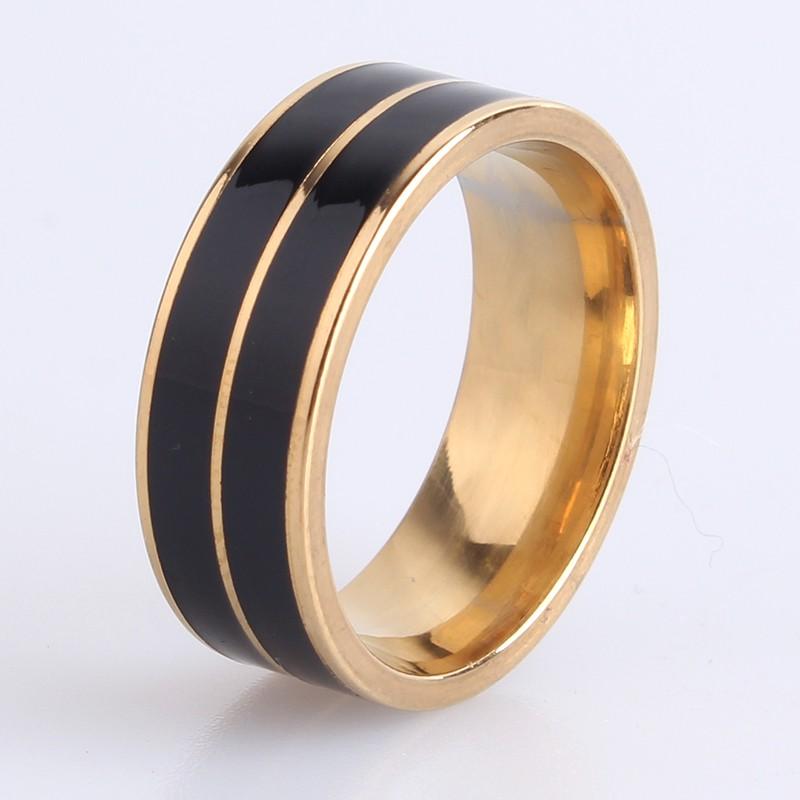 Чёрное кольцо «Gedeon» из нержавеющей стали с напылением под жёлтое золото купить. Цена 185 грн