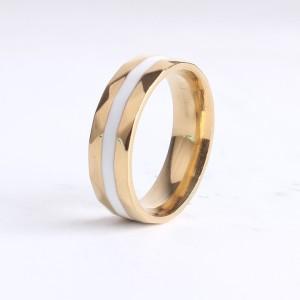 Гранёное кольцо «Gedeon» с желтым напылением под золото и белой полосой из керамики купить. Цена 210 грн