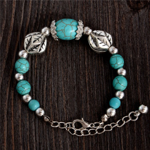 Бирюзовый браслет в тибетском стиле с металлическим бусинами под старинное серебро фото. Купить