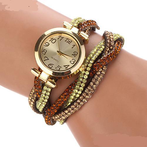 Яркие часы «Quartz» с золотым корпусом и длинным коричневым ремешком со стразами купить. Цена 265 грн