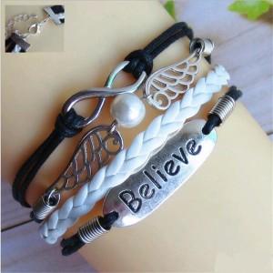 Чёрный браслет «Инфинити» из вощёного шнура с серебристыми крыльями и планкой с надписью фото. Купить