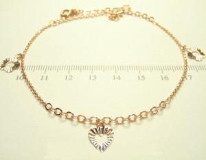 Модный браслет-цепочка на ногу с висюльками в форме сердец и розовой позолотой купить. Цена 135 грн или 425 руб.