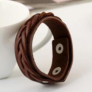 Коричневый браслет с косичкой на полосе из натуральной кожи купить. Цена 135 грн или 425 руб.