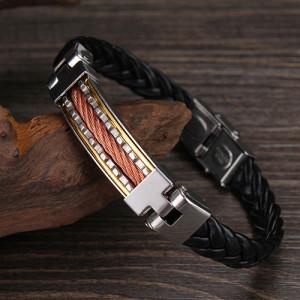 Комбинированный браслет в виде чёрной плетёной косички с металлической вставкой фото. Купить