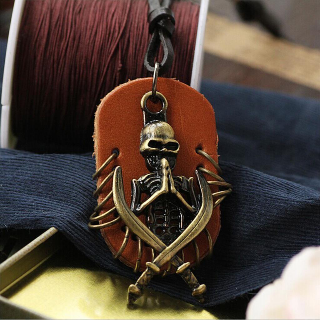 Крутая подвеска из кожи с бронзовым скелетом и мечами на кожаном кулоне купить. Цена 199 грн