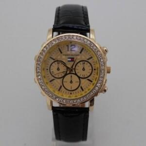 Женские часы «Tommy Hilfiger» в золотом цвете с чёрным ремешком фото. Купить