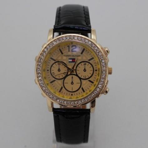 Женские часы «Tommy Hilfiger» в золотом цвете с чёрным ремешком купить. Цена 275 грн