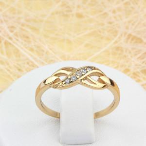 Модное кольцо «Абсолют» в виде знака бесконечности с мелкими фианитами в позолоте фото. Купить