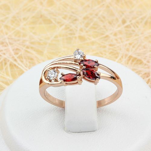 Неотразимое кольцо «Ирисы» с красными фианитами в тонкой оправе с золотым покрытием купить. Цена 175 грн