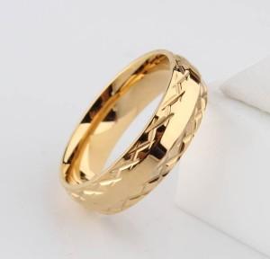 Стальное кольцо фирмы «Gedeon» золотого цвета с красивым рельефным орнаментом купить. Цена 185 грн
