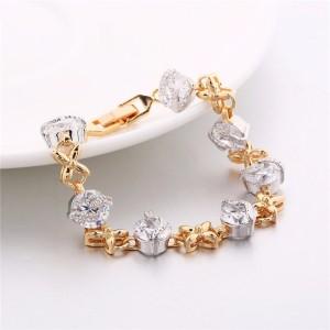 Двухцветный браслет «Пилигрим» с крупными фианитами и покрытием из жёлтого и белого золота купить. Цена 370 грн или 1160 руб.
