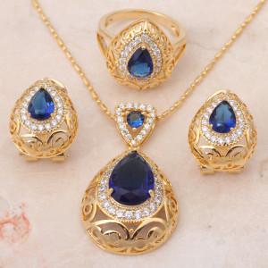 Богатый комплект «Борнео» с красивым синим цирконом и качественным золотым напылением фото. Купить