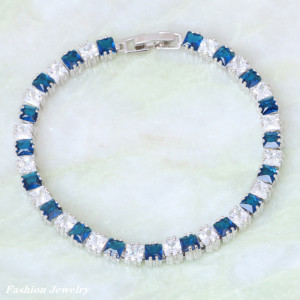Дорогой браслет «Эверест» с синими и белыми цирконами квадратной формы в родиевой оправе купить. Цена 480 грн или 1500 руб.