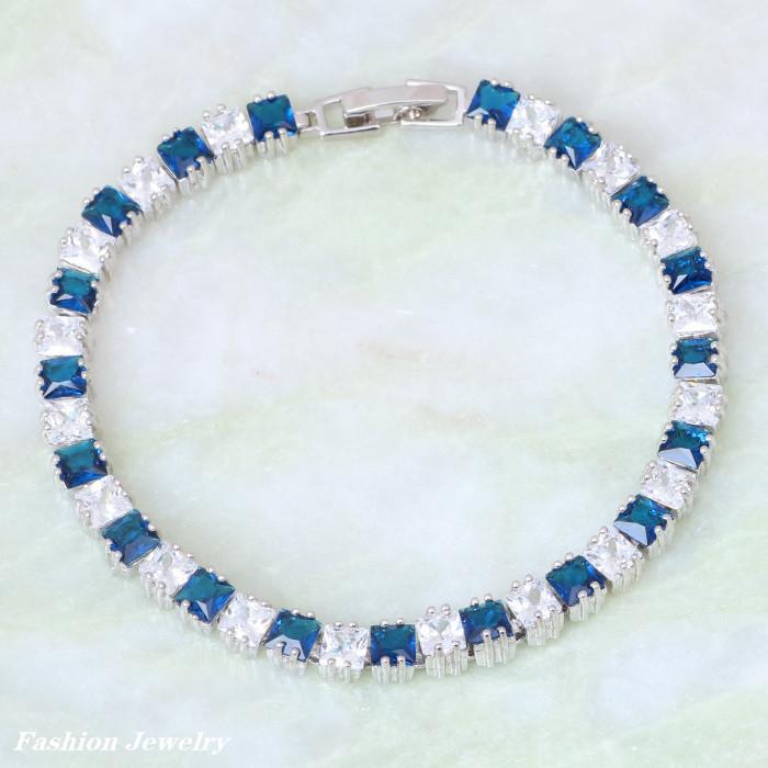 Дорогой браслет «Эверест» с синими и белыми цирконами квадратной формы в родиевой оправе купить. Цена 480 грн