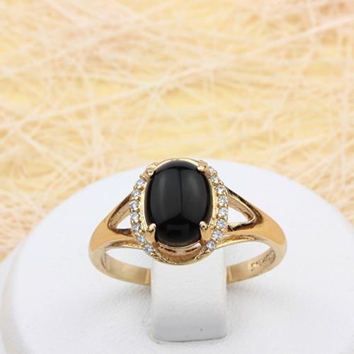 Таинственное кольцо «Оракул» с чёрным овальным камнем и мелкими цирконами в позолоченной оправе купить. Цена 185 грн