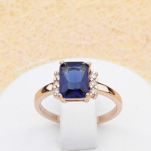 Аккуратное кольцо «Пандора» с прямоугольным камнем синего цвета и золотым напылением купить. Цена 165 грн