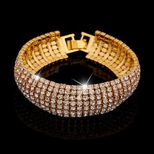 Праздничный браслет «Невеста» в виде ленты из блестящих страз в жёлтом металле фото. Купить