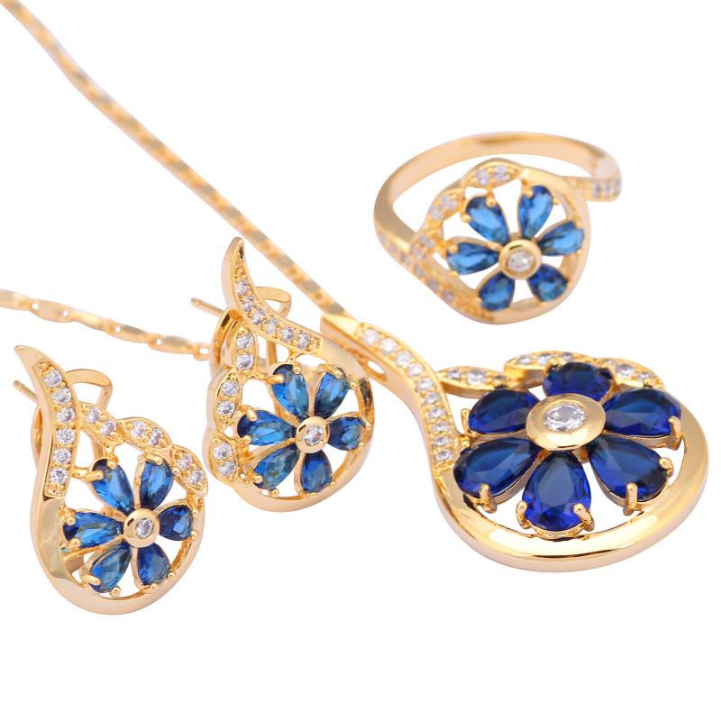 Неповторимый комплект «Малена» в форме цветка с синими цирконами и 18-ти каратной позолотой купить. Цена 690 грн