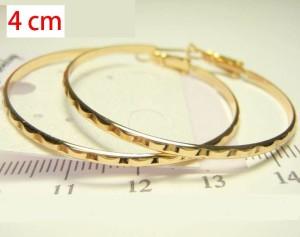 Волнистые серьги в форме колец с золотым напылением без камней и вставок фото. Купить