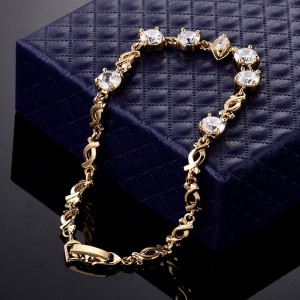 Хорошенький браслет «Вольта» классического дизайна с бесцветными цирконами и отличной позолотой фото. Купить