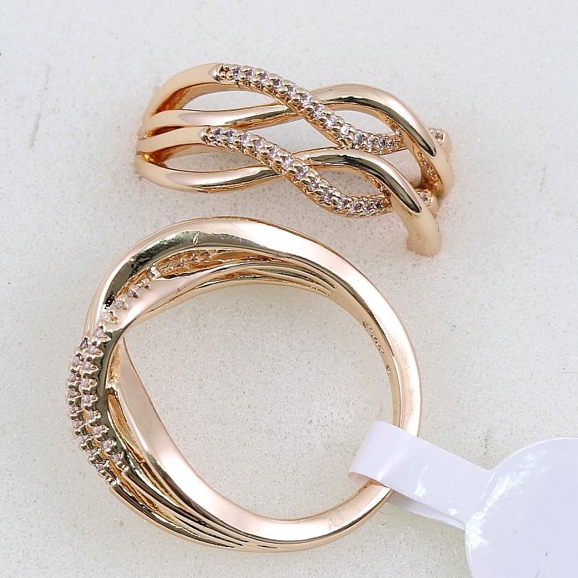 Красивое кольцо «Волнистое» с мелкими камнями и покрытием из розового золота купить. Цена 175 грн