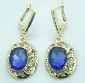 Симпатичные серьги «Аврелия» под золото овальной формы с синим камнем и стразами фото. Купить
