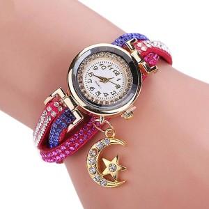 Яркие женские часы «Quartz» с малиновым ремешком с цветными стразами и кулоном купить. Цена 220 грн