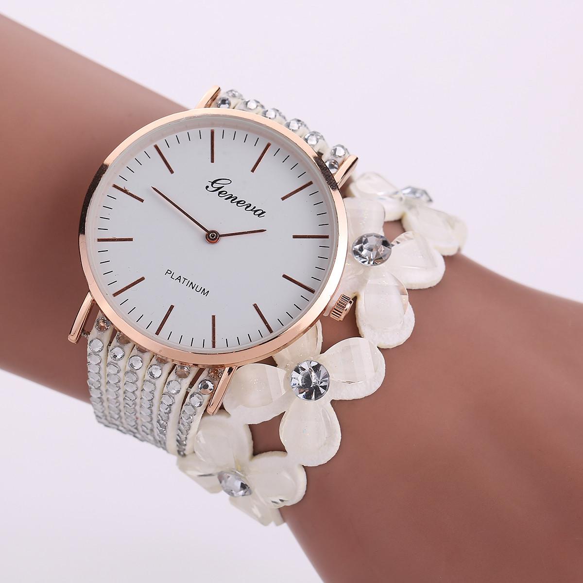 Крупные круглые часы «Geneva» с длинным белым ремешком из страз и цветов купить. Цена 299 грн