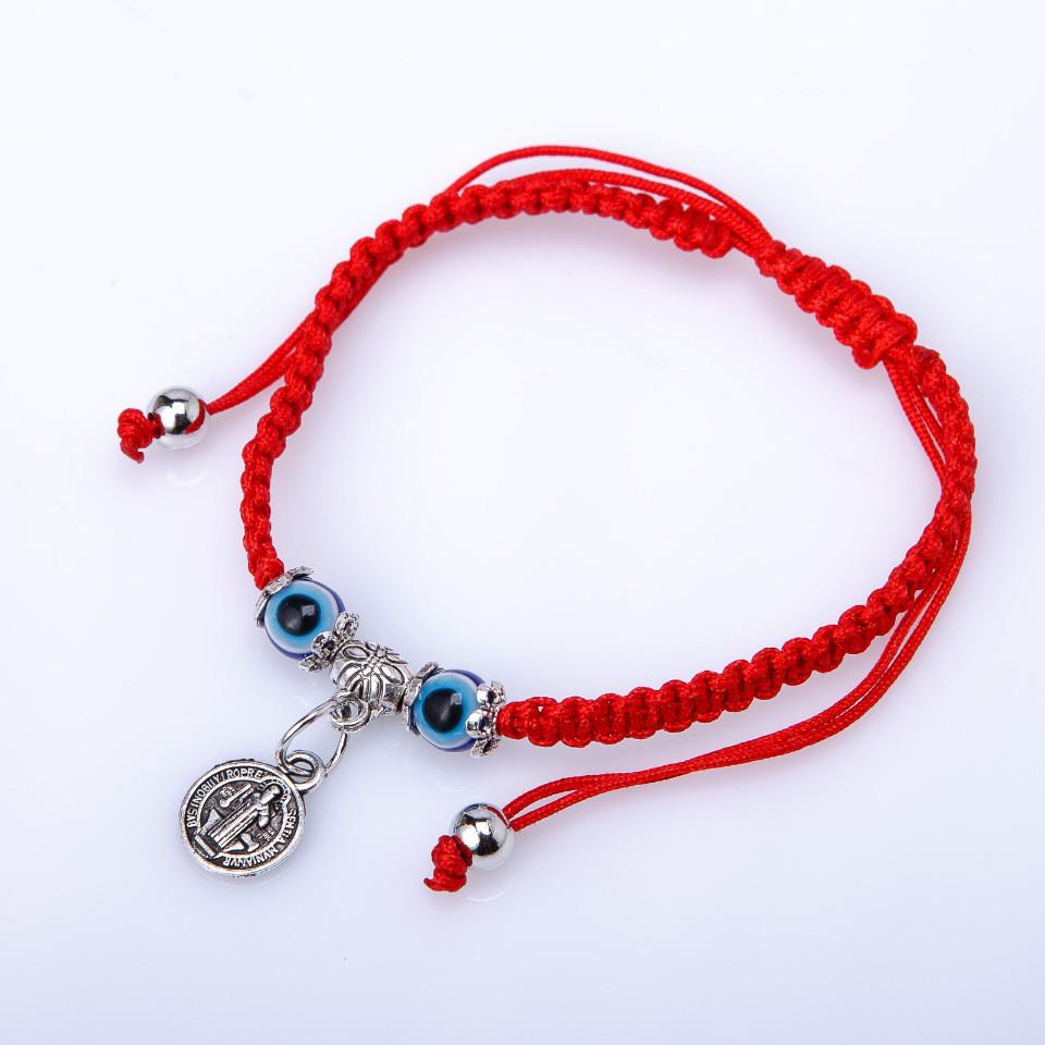 Плетёный браслет из красной нити с ладанкой-висюлькой купить. Цена 69 грн