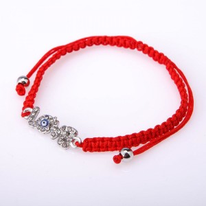 Популярный браслет-амулет в виде красной нити с буквами «LOVE» купить. Цена 65 грн